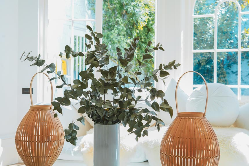 Greenery looks so amazing in an all-white interior like this, especially when paired with rattan basket lanterns.