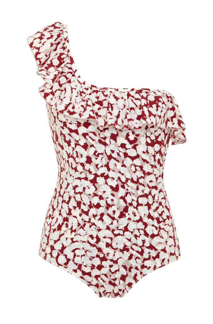 A red and white flower print one piece swimsuit with a one shoulder strap. Image by Very Exclusive.