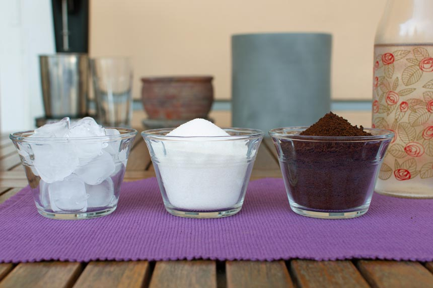 The ingredients for a frappe coffee. Three bowls with ice on the left, sugar in the middle and Nescafe coffee on the right. Image by Antonis Drakakis.