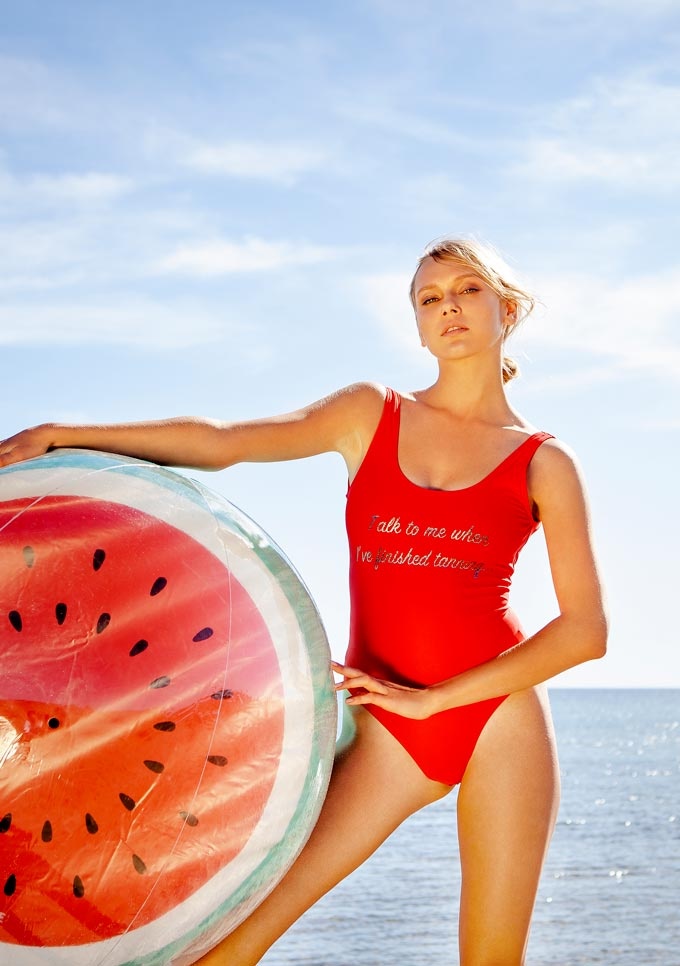 I want one of those large watermelon inflatable mattress along with that red one piece swimsuit the blonde woman is wearing. Is that too much to ask? Image by Pretty Me.