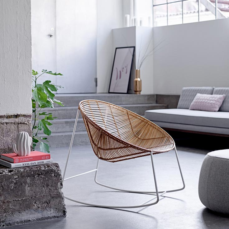 Love this idea! A rattan rocking chair as an accent that looks so elegant in a grey minimal living space. Image by Amara.