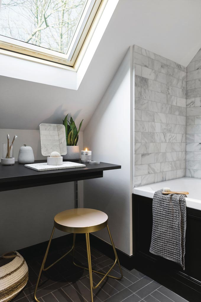 Part of an elegant bathroom with a boudoir under the sloped roof. All is minimal. Image by Amara.