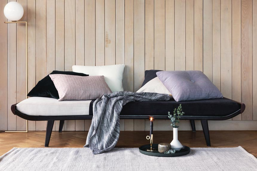 A daybed against a plank wall styled beautifully. Image by Amara.