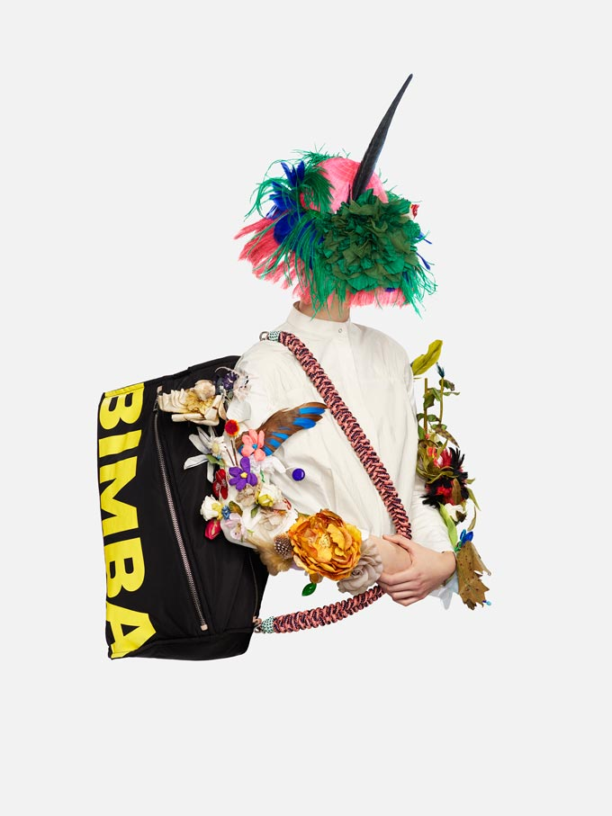 A creative image by Bimba Y Lola of a model wearing a large bag with a big Bimba Y Lola logo.
