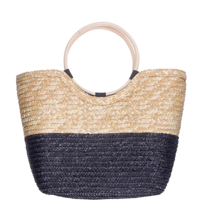 A color blocked beige and black straw bag with a round handle. Image by Dorothy Perkins.