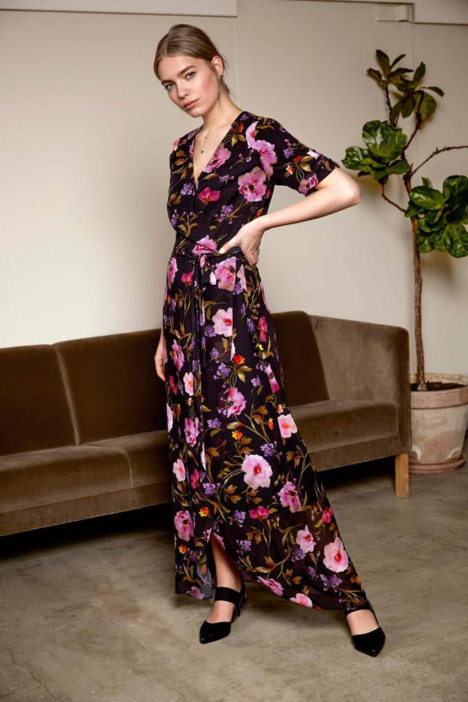 A beautiful floral maxi dress worn by a pretty woman. Image by Long Tall Sally.