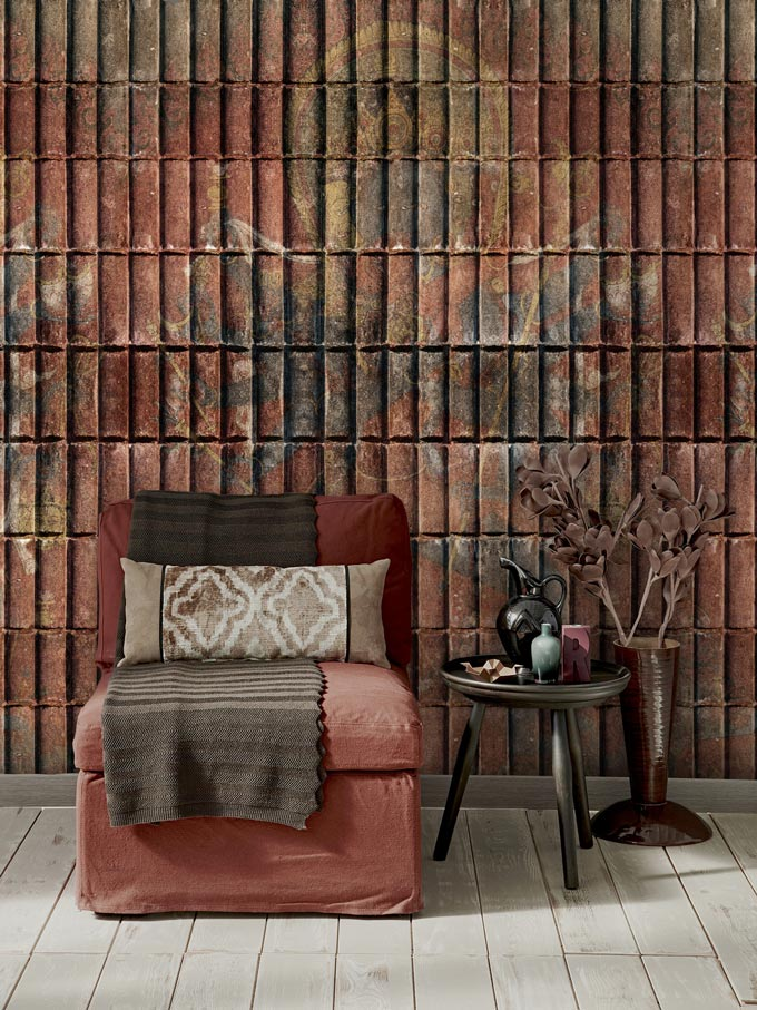 What an amazing wallpapers in rusty hues as a background for a rusty hued chair and side table. Image of a beautiful vignette by MindTheGap.