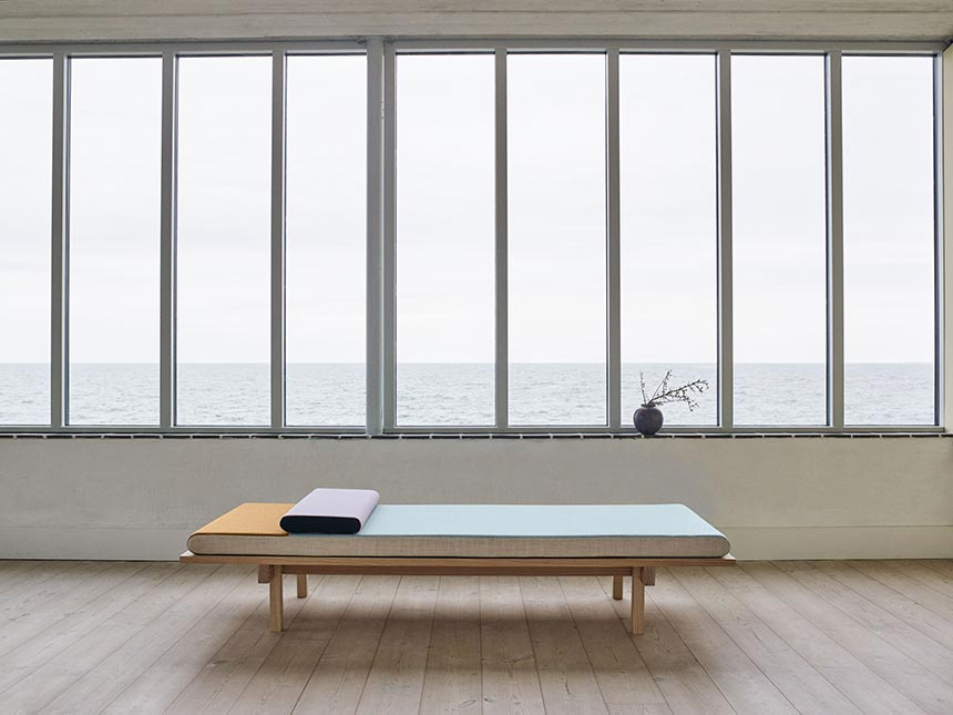 The Skagerak Reykjavik DaybedA contemporary minimal daybed in a room filled with windows. Image by Nest.co.uk.