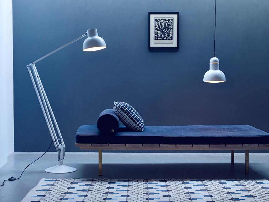 A blue room with a blue daybed and a statement floor lamp can be such a minimal but inviting space when done right. Image by Nest.co.uk.