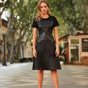 So stylish! I love this faux leather front panel black dress. This beautiful woman has paired with leopard print high heels. Image by Sosandar.