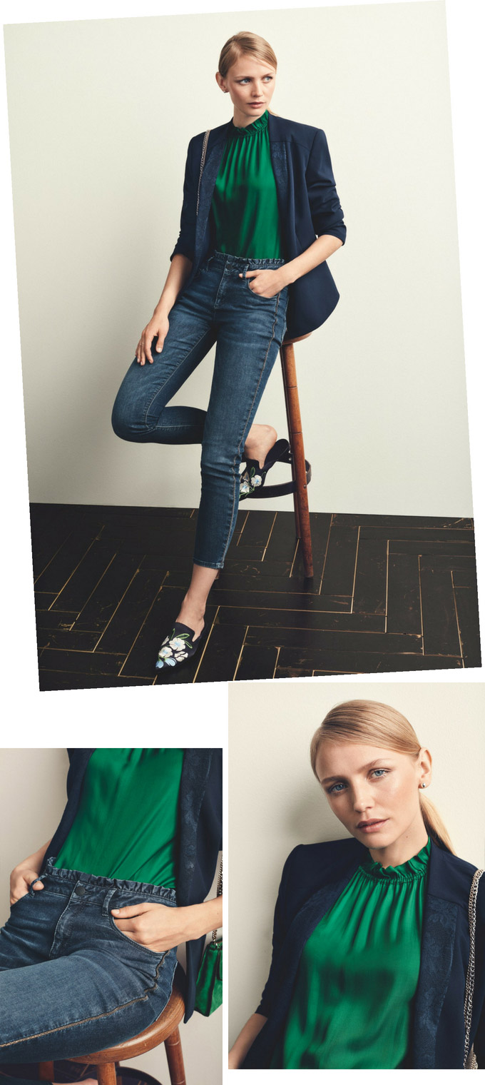A royal green blouse looks perfect with a navy blue blazer over blue denim pants as worn by this blonde woman. Images by Betty and Co.