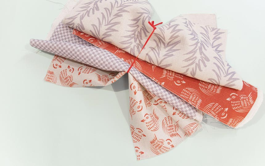 A lovely assortment of linens with various patterns and soft colors. Image by All The Fruits.