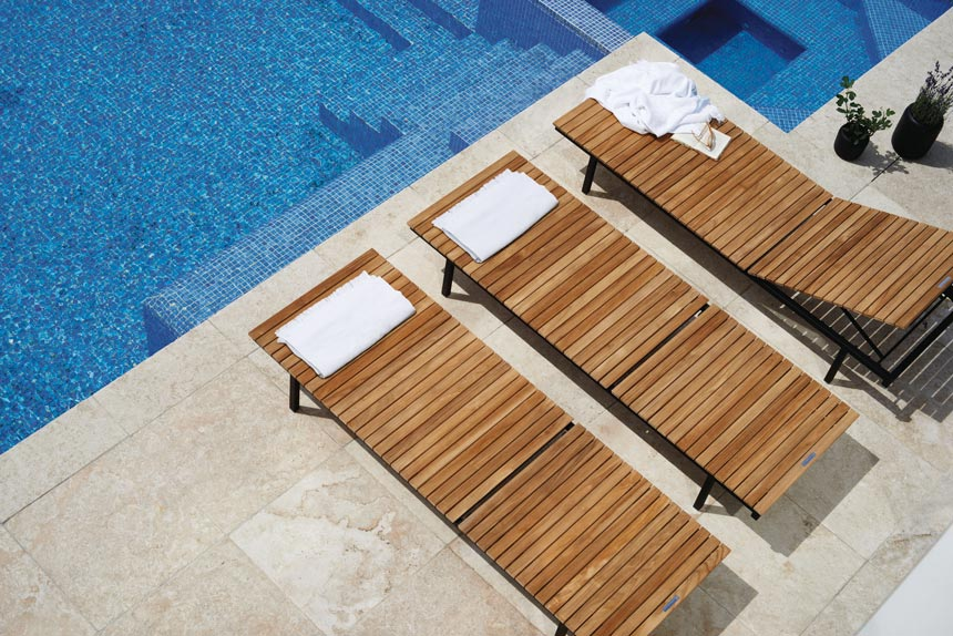 Three Skargaarden Haringe Sun Loungers by the pool viewed from atop. Image by Houseology.