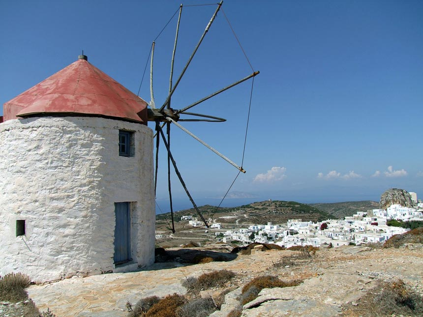 View of a mill with the town, Chora, of Amorgos in the background.