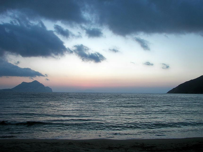Sunset from Aegiali beach overlooking the Aegean Sea.