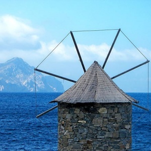 An old mill in the foreground and the Aegean Sea in the background. View from Amorgos.
