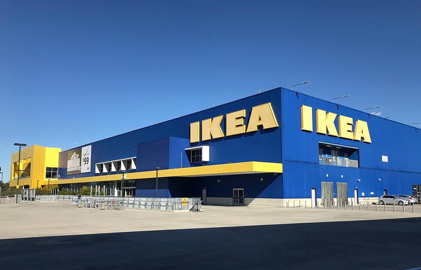 An IKEA warehouse shown on a sunny day.