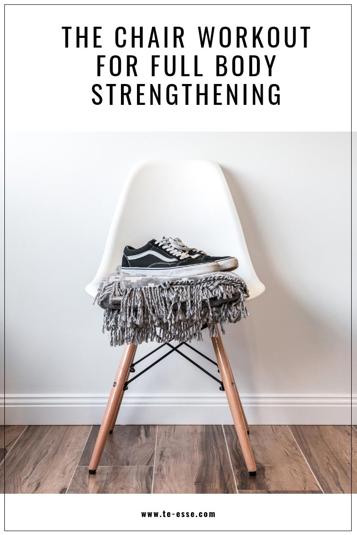 A pin graphic showing a white chair with wooden legs against a white wall with a throw on the seat and a pair of black trainers atop. At the top of the graphic it reads The Chair Workout for Full Body Strengthening.