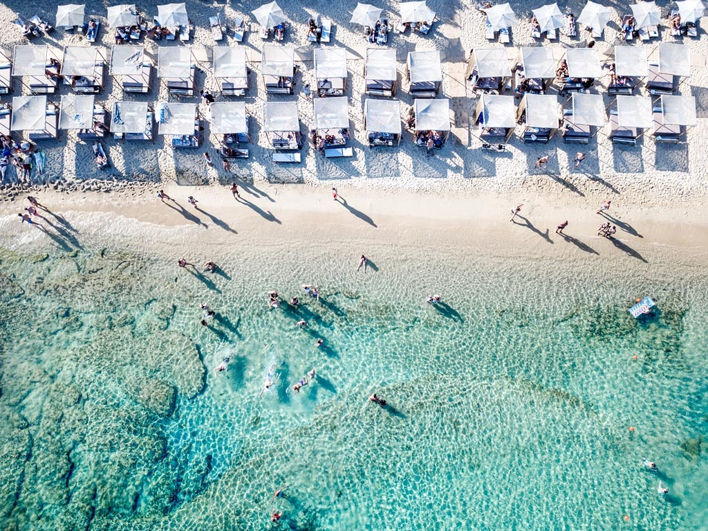 A bird's eye view of a beach in Mykonos. Image by Marina Vernicos.