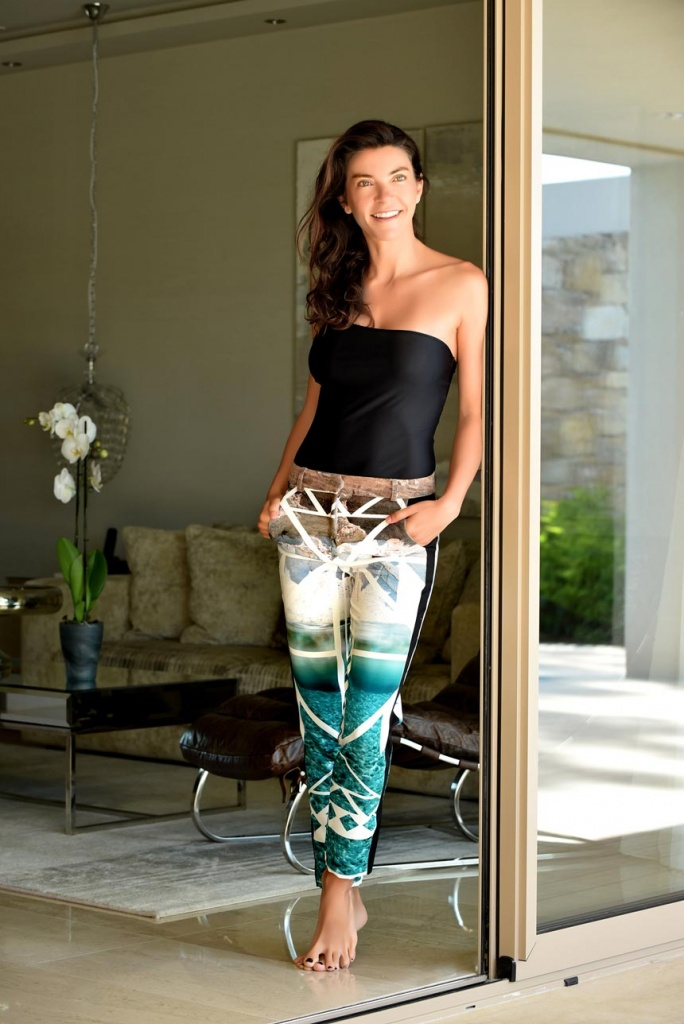 Lifestyle image of Marina Vernicos dressed with clothes from her own collection line.