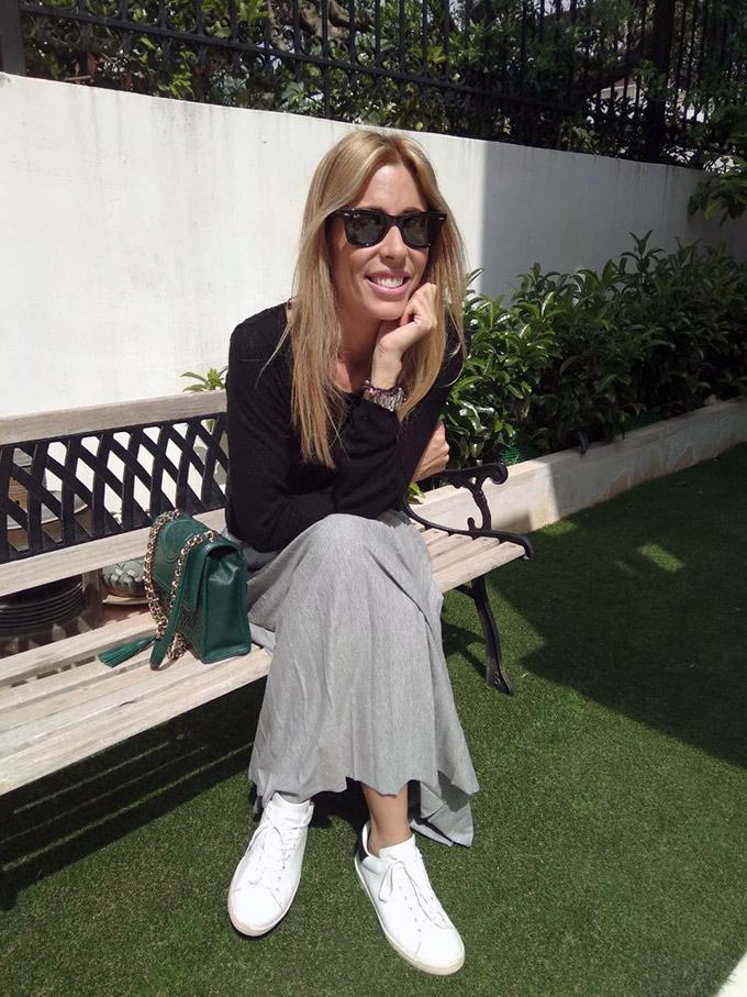 Elisabeth sitting on a bench in Velvet's garden.