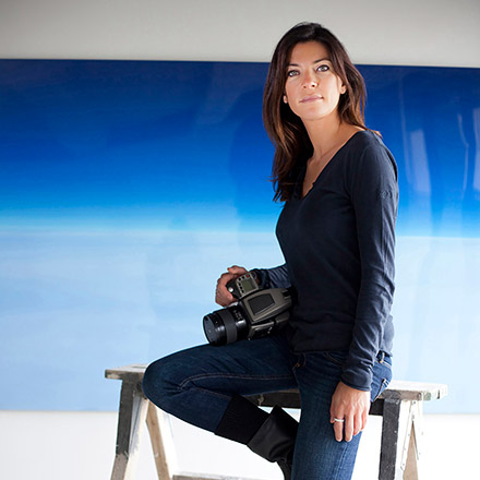 A portrait of Marina Vernicos with her camera while in action.