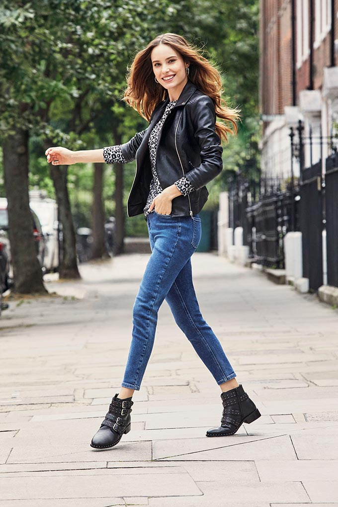 Love the look of this stylish young woman in a black leather jacket, a leopard print top, denim pants and black ankle boots with buckles. Image by Dorothy Perkins.
