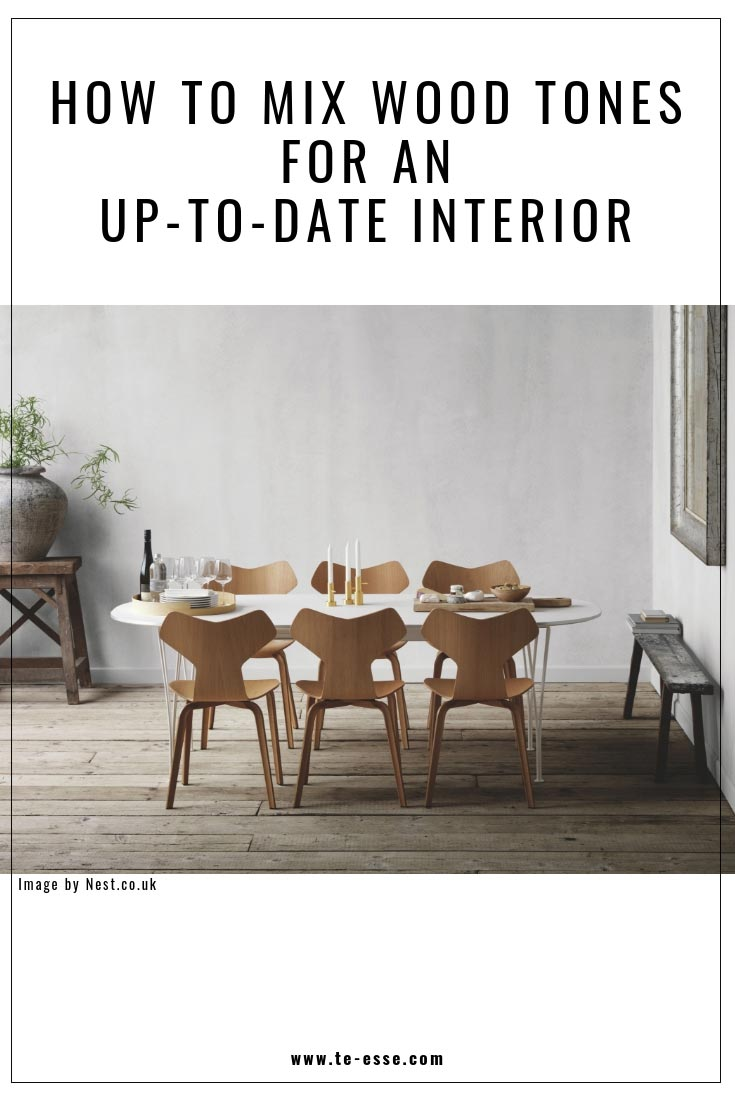 A pin graphic titled how to mix wood tones for an up-to-date interior using an image by Nest.co.uk of a contemporary minimal dining space that includes different sorts of woods.