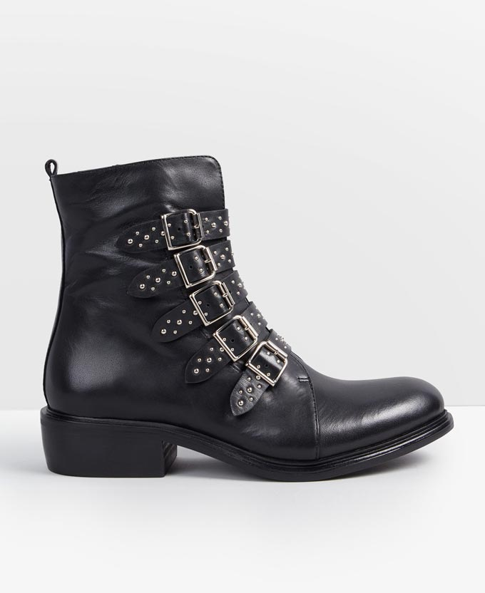 A black ankle boot with lots of straps and buckles. Looks a bit like a combat boot but without laces. Image by Hush.