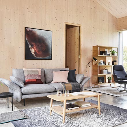 A beautiful Scandi interior with light stain wood accent floors, walls and ceiling that creates such a cozy warmth. Image by John Lewis.