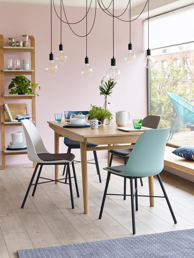 An informal dining space that looks awesome with a large window from floor to ceiling for some great view and hanging pendant lights. Image by John Lewis.