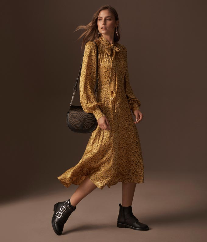 Love this ochre print dress paired with black ankle boots with several buckles. Image by Marks & Spencer.