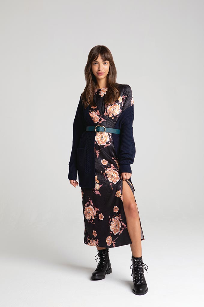 A lovely black dress with a pink flower print, a black cardigan and black combat boots might sound unconventional but look great on this young woman. Image by Miss Selfridge.