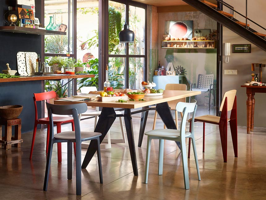 Love this creative busy looking dining space with different dining chairs including Vitra all plastic chair. Image by Nest.
