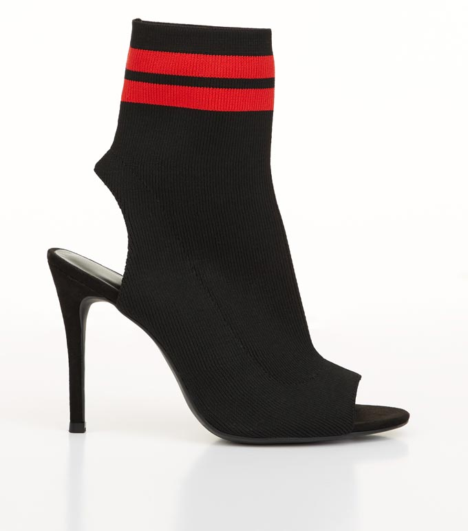 A black and red sock ankle boot with a peep toe and stiletto heel. Image by New Look.