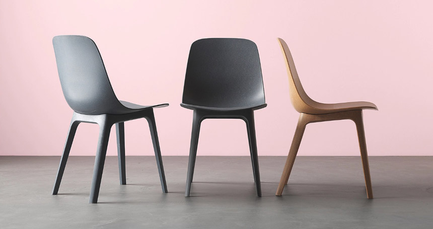 Three Odger chairs from IKEA in different colors.