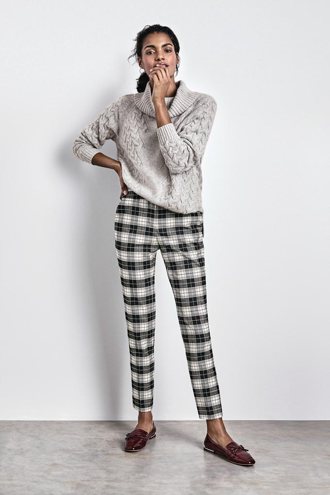 Love these plaid grey pants paired with this soft looking grey sweater worn by a beautiful woman. Image by Pure Collection.