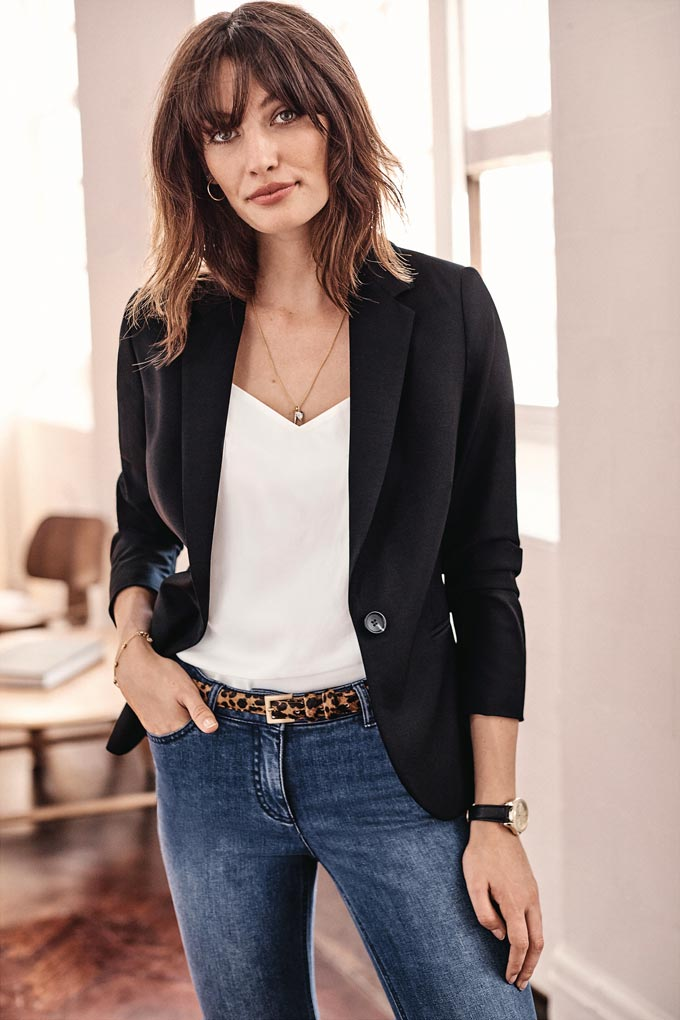 Wow, she looks so French chic dressed with a black blazer, white top, leopard print belt and denims. Image by Pure Collection.