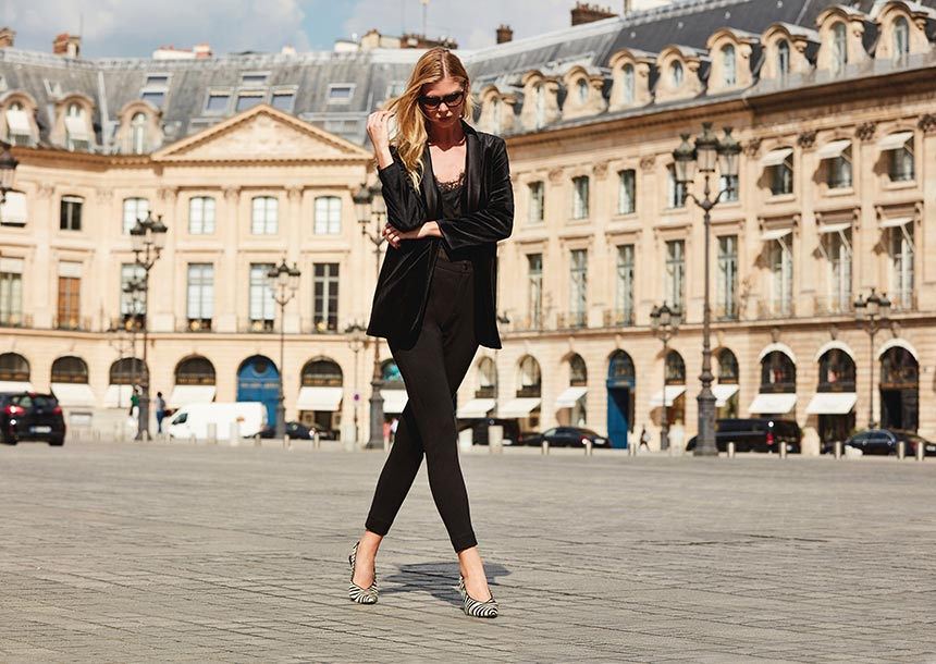 Wow, love this all black outfit paired with zebra print high heels, worn by a young blonde woman in Place Vendome in Paris. Image by Sosandar.