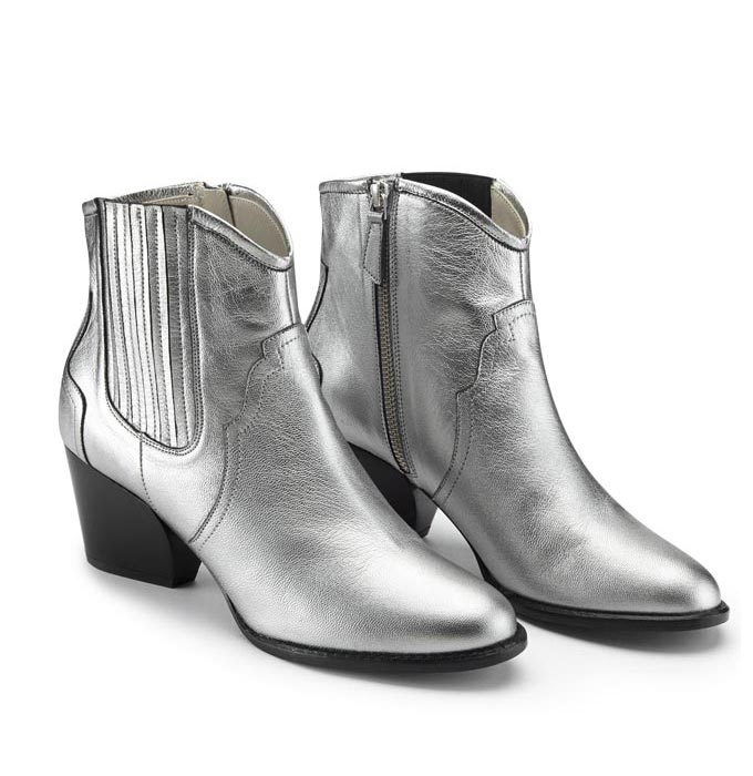 A pair of silver western ankle boots. Cut-out image by Sosandar.