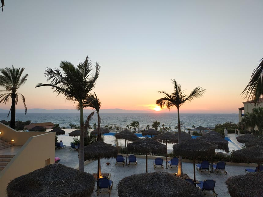 An idyllic view of the pools and the sea shore at sunset hours.