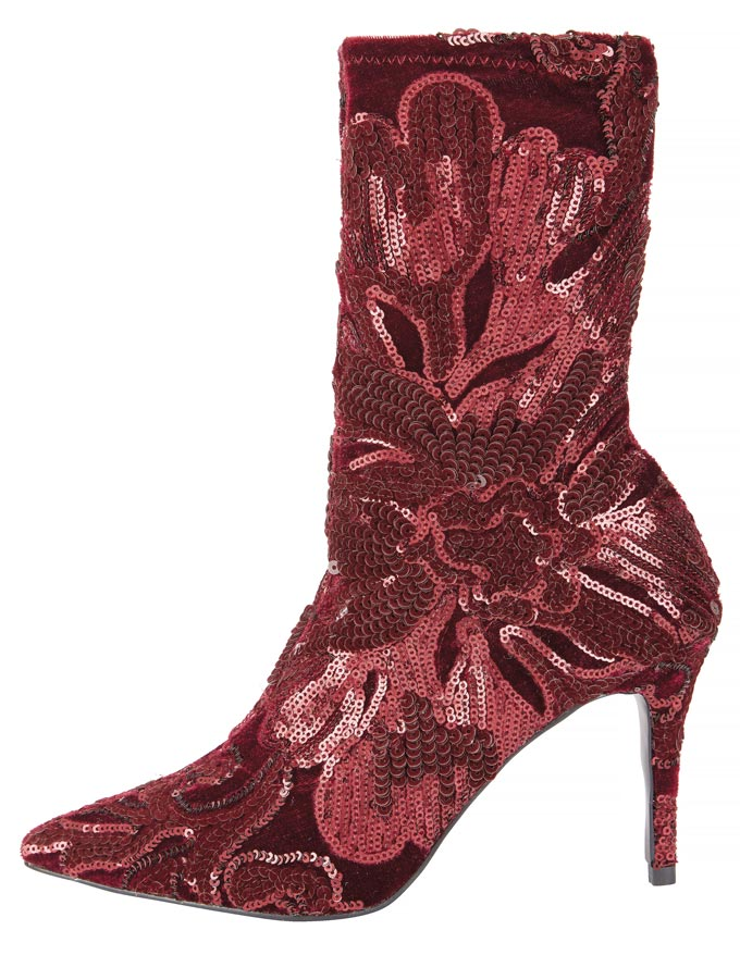 A red boot embellished with sequins in a floral pattern. Image by Very.