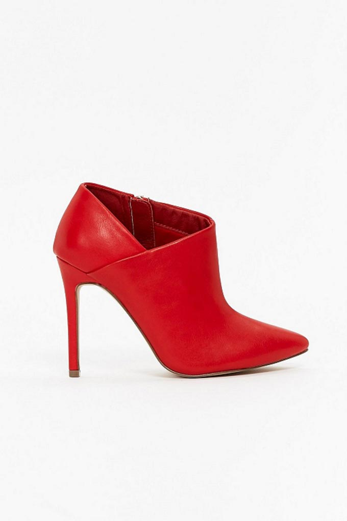 A red stiletto ankle boot with a V side cut. Image by Wallis.