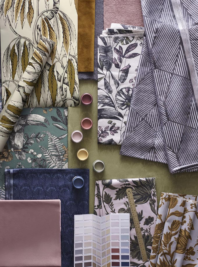 A flatlay with tropical leaves pattern wallpaper, textiles and color samples. Image by John Lewis.