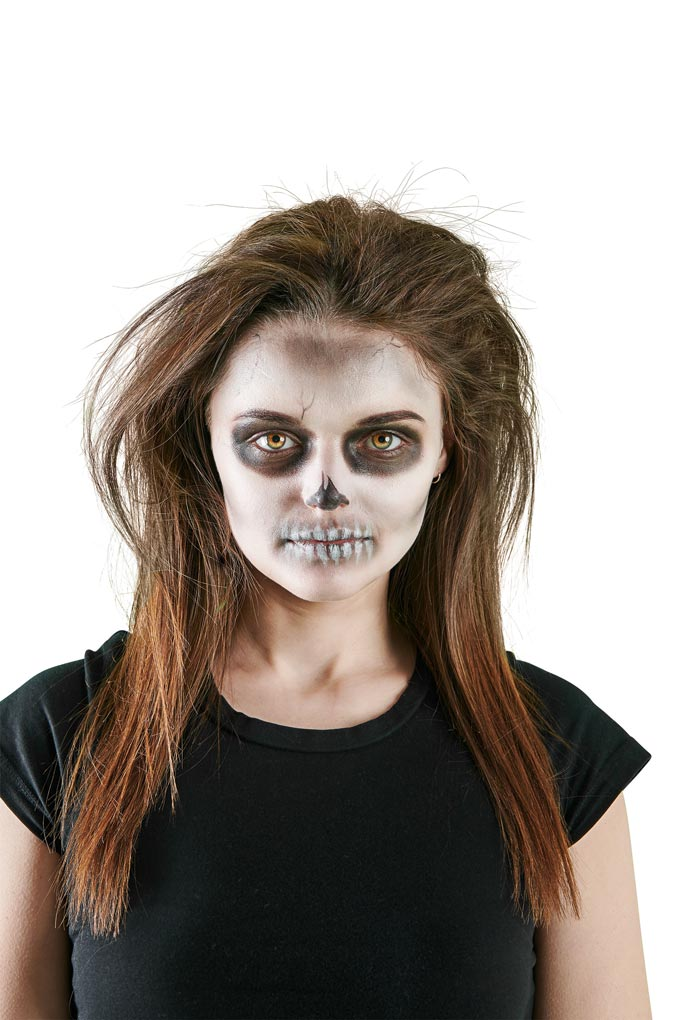 Scary! A woman's painted face for Halloween like a scull looks creepy... Image by Wilco.