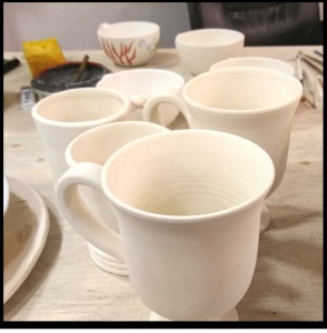 Mugs made of clay that will be painted by Maria Banou. Image by Velvet.
