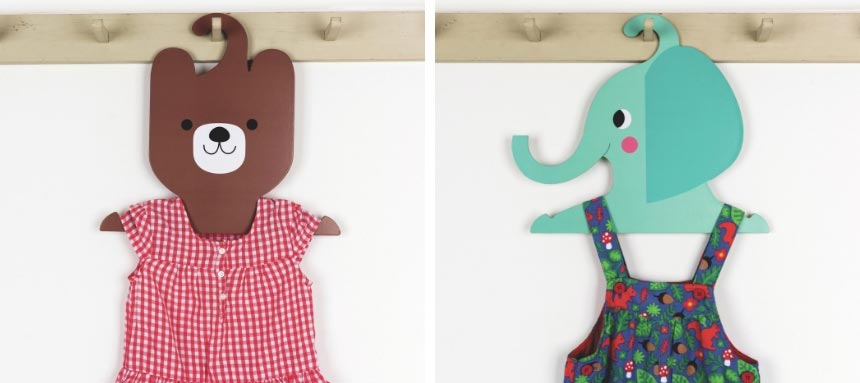 On the left a teddy bear animal coat hanger. On the right a blue elephant coat hanger. So cute. Images by Rexlondon.