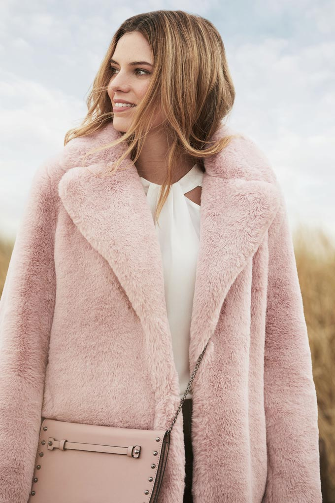 I love this pink fur coat with a white top under it. So feminine. Image by Dorothy Perkins.