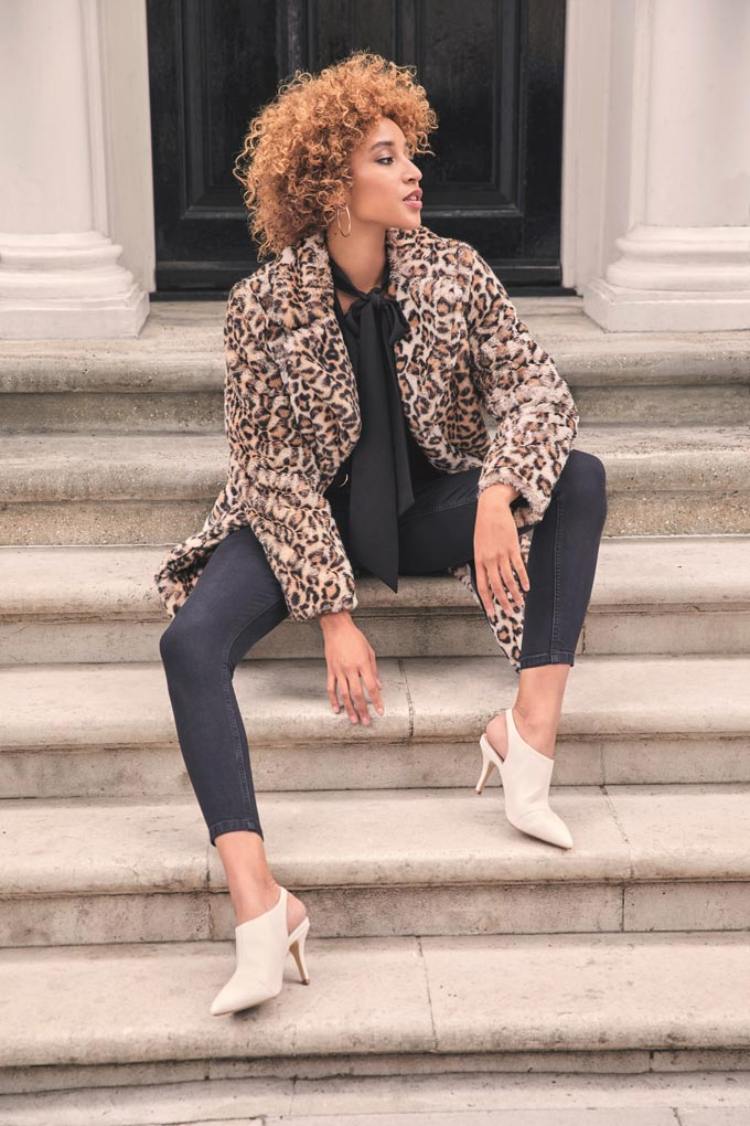 A leopard faux fur coat is not a bad idea. Go for a tailored one like this and pair it will an all black outfit. Image by Dorothy Perkins.