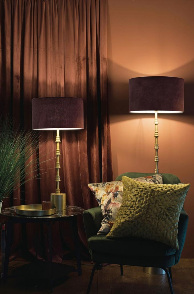 I have a soft spot for deep saturated colors, and this terracotta accent wall with those table lamps and color coordinated drapes and forest green pillows on the armchair are no exception. Love. Image by Harvey Norman.